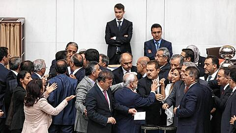 Turkish lawmakers vote on a bill lifting immunity