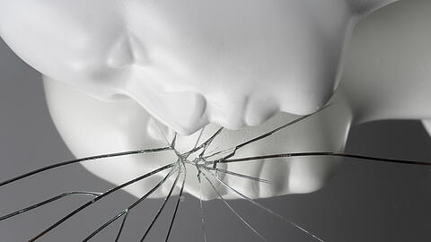 white man mannequin with broken crack reflection mirror in crime or violence scene