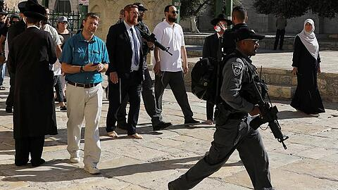 Israeli policemen escort Yehuda Glick, a member of Knesset, the Israeli parliament, as he visits the compound known to Muslims as Noble Sanctuary and to Jews as Temple Mount, in Jerusalem's Old City