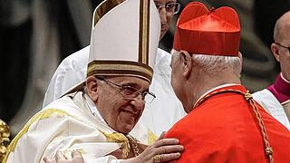 Pope Francis embraces newly elected cardinal Muller of Germany during a consistory ceremony in Saint Peter's Basilica at the Vatican