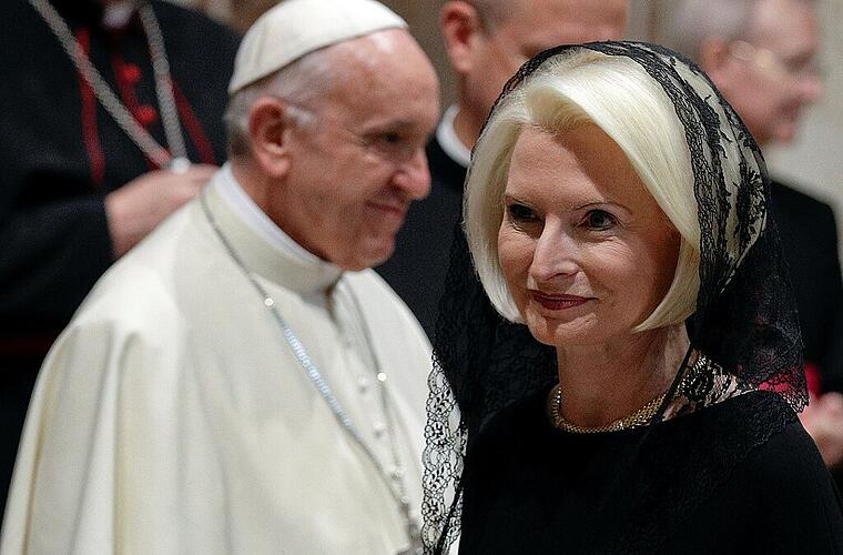 U.S. ambassador to the Holy See Callista Gingrich walks past Pope Francis during the traditional exchange of the New Year greetings in the Regal Room at the Vatican