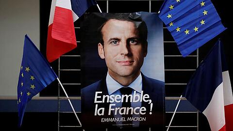 FILE PHOTO: An electoral poster of Emmanuel Macron, head of the political movement En Marche !, or Onwards !, and candidate for the 2017 presidential election, is displayed during a campaign rally in Paris