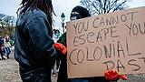 December 6, 2020, The Hague, Netherlands: A protester holds a placard against colonialism during the demonstration..Sev
