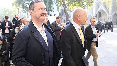 Gareth Lee, and Michael Wardlow of the Equalities Commission, leave after speaking outside the Supreme Court in London