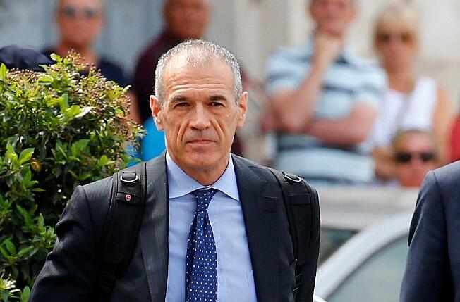 Former senior International Monetary Fund (IMF) official Carlo Cottarelli arrives before a meeting with  Italy's President Sergio Mattarella at the Quirinal Palace in Rome