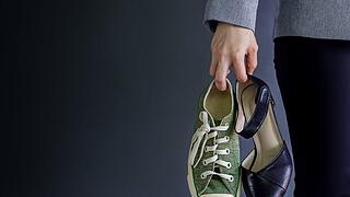 Work Life Balance Concept, present by Business Working Woman holding a High Heal and Sneaker Shoes, Croped image with Copy Space