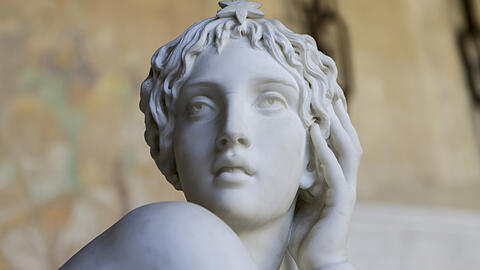 Marble sculpture of beautiful woman in a greek style
