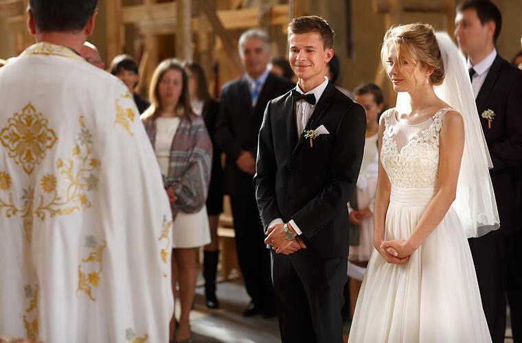 classic wedding ceremony of stylish young luxury bride and groom