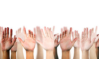 hand raised up on white isolated background