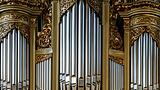 Beautiful old organ decorated by gold