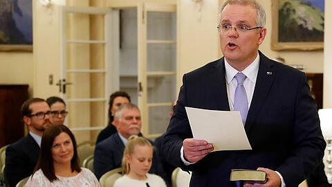 The new Australian Prime Minister Scott Morrison attends a swearing-in ceremony in Canberra