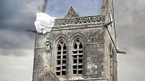 D-DAY. Paratrooper hanging from church, St. Mere Eglise, Normandy, France