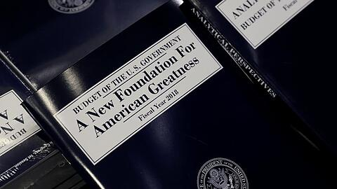 Copies of the budget are distributed on Capitol Hill in Washington