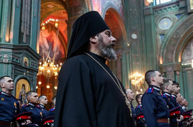 MOSCOW REGION, RUSSIA - JUNE 23, 2020: Father Superior Stefan (front), bishop of Klin, and servicemen attend a church se