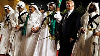 Trump dances with a sword as he arrives to a welcome ceremony by Saudi Arabia's King Salman at Al Murabba Palace in Riyadh